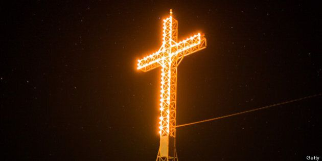 LAC-MEGANTIC, CANADA - JULY 13: The giant, illuminated cross that hangs over Lac-Megantic is seen, July...