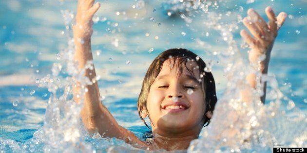 kid splashing on summer