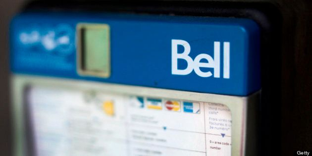 A Bell Canada pay phone stands in this photograph taken with a tilt-shift lens in Toronto, Ontario, Canada,...
