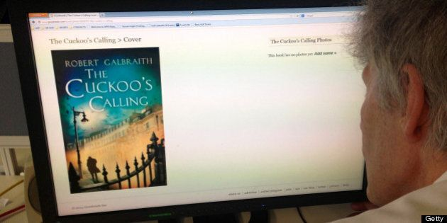 A man looks at the cover photo of the book 'The Cuckoo's Calling' by Robert Galbraith, a pseudonym for...
