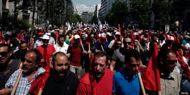 Greek communist union PAME members shout slogans against the Greek government during a general strike...