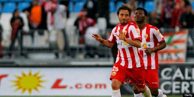 Almeria's Argentinian midfielder Hernan Bernardello (L) celebrates after scoring during the Spanish league...