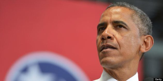 US President Barack Obama speaks on job growth following a tour of an Amazon fulfillment center on July...