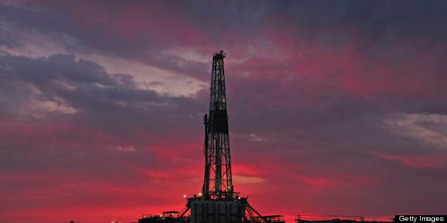 A silhouette shot of a drilling rig at