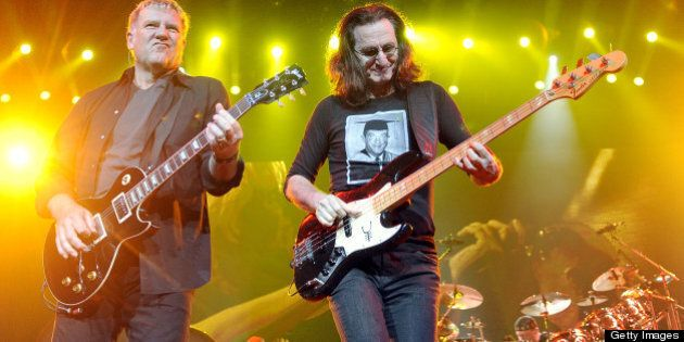 SAN JOSE, CA - NOVEMBER 15: (L - R) Alex Lifeson, Geddy Lee, and Neil Peart of Rush perform part of the...
