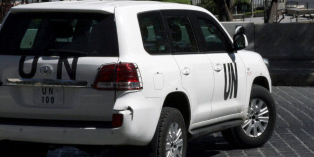 A United Nations vehicle carrying inspectors from the Organisation for the Prohibition of Chemical Weapons (OPCW) leaves a hotel in Damascus on October 11, 2013. The watchdog now overseeing the destruction of Syria's chemical arsenal won the Nobel Peace Prize for its efforts to rid the world of the devastating weapons. AFP PHOTO / JIANG TIEYING (Photo credit should read JIANG TIEYING/AFP/Getty Images)