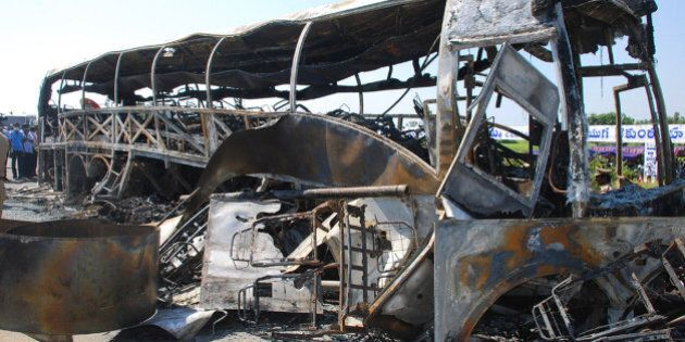 The skelatal remains of a burnt-out bus which was travelling from Bangalore to Hyderabad, are seen on...