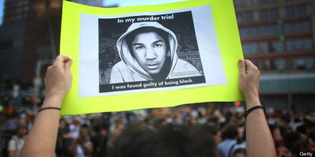 NEW YORK, NY - JULY 14: A protester holds a sign at a rally honoring Trayvon Martin at Union Square in...