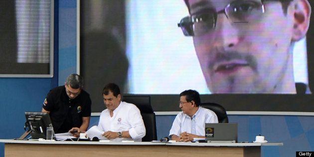 Ecuadorean President Rafael Correa checks some documents during his programme 'Enlace Ciudadano', at...
