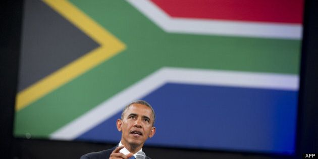 Obama salue le «courage moral» de Mandela et rencontre sa