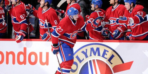 MONTREAL, CANADA - APRIL 4: Alex Galchenyuk #27 of the Montreal Canadiens celebrates his third-period...