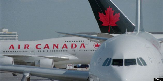 Pics of travellers in line at Air Canada deaparture area,travellers and people looking at departure board...