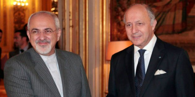 French Foreign Minister Laurent Fabius (R) welcomes his Iranian counterpart Mohammad Javad Zarif at the...