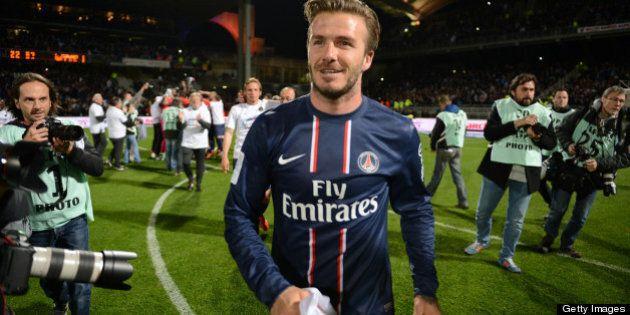 Paris' British midfielder David Beckham celebrates after Paris Saint-Germain won the French L1 title...
