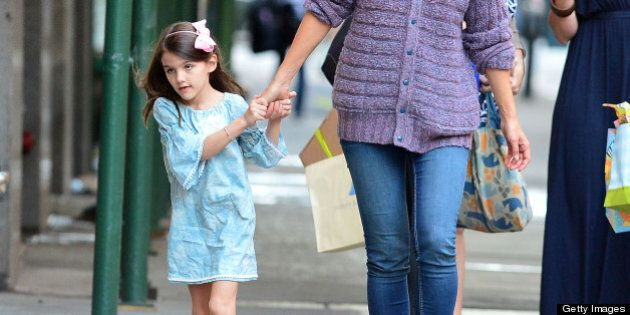 NEW YORK, NY - SEPTEMBER 16:  Katie Holmes and Suri Cruise (L) seen on the streets of Manhattan on September 16, 2012 in New York City.  (Photo by James Devaney/FilmMagic)