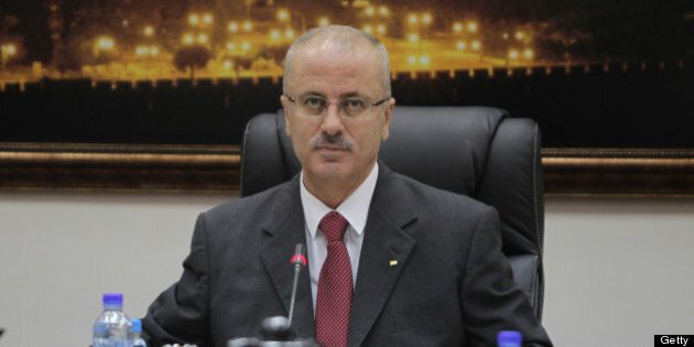 Palestinian Prime Minister Rami Hamdallah chairs the first working meeting of the new Palestinian government...