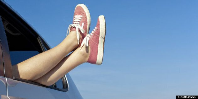 young woman relaxing in her car ...