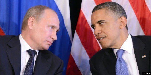 US President Barack Obama (R) listens to Russian President Vladimir Putin after their bilateral meeting...