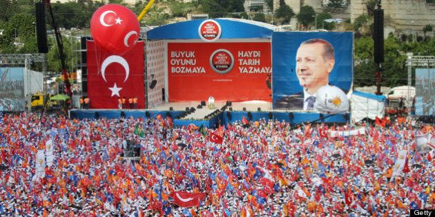 People gather during a rally at the Kazlicesma meeting area in Istanbul to listen to a speech by Turkish...