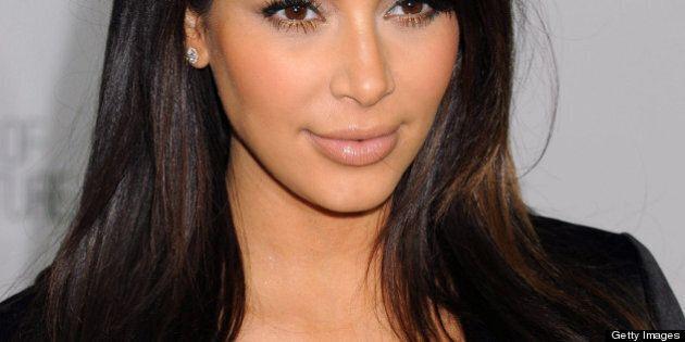 NEW YORK, NY - APRIL 22: TV personality Kim Kardashian attends the E! 2013 Upfront at The Grand Ballroom...