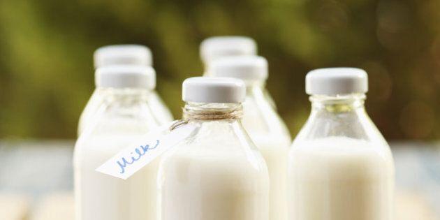 Milk bottles arranged in rows on a wooden
