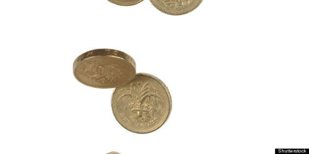 uk pound coins falling into a...