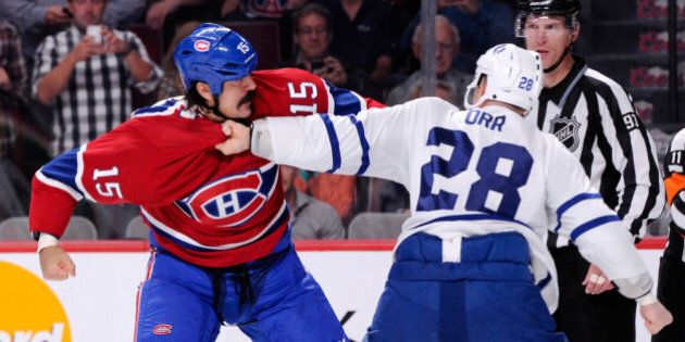 MONTREAL, QC - OCTOBER 1:  George Parros #15 of the Montreal Canadiens and Colton Orr #28 of the Toronto Maple Leafs fight during the second period of the NHL game at the Bell Centre on October 1, 2013 in Montreal, Quebec, Canada.    (Photo by Richard Wolowicz/Getty Images)