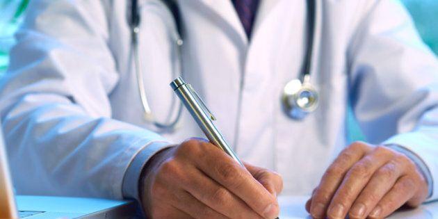 Doctor writing prescription selective