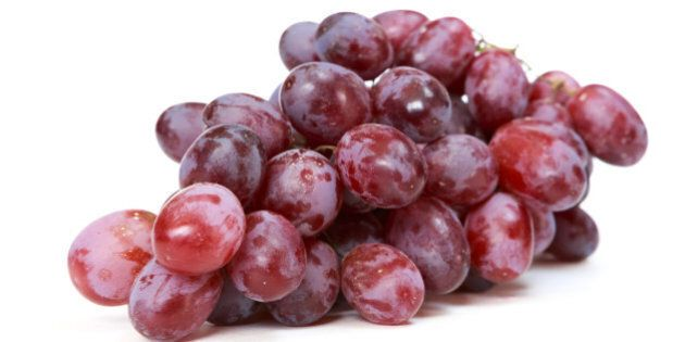 red grapes over white