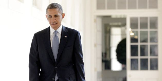 WASHINGTON, DC - SEPTEMBER 10: U.S. President Barack Obama walks to the Oval Office September 10, 2013...