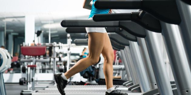 woman running on a treadmill in