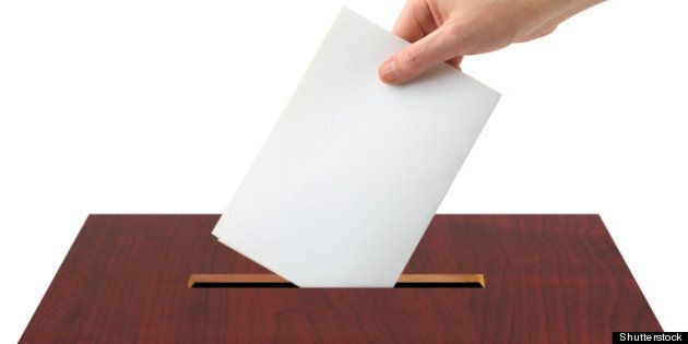 hand with ballot and