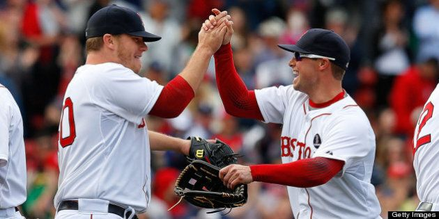 BOSTON, MA - APRIL 20:  Andrew Bailey #40 of the Boston Red Sox celebrates with Daniel Nava #29 after defeating the Kansas City Royals, 4-3, at Fenway Park on April 20, 2013 in Boston, Massachusetts.  (Photo by Jim Rogash/Getty Images)
