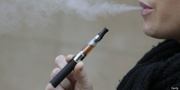 A person smokes an electronic cigarette on March 05, 2013 in Paris. AFP PHOTO / KENZO TRIBOUILLARD        (Photo credit should read KENZO TRIBOUILLARD/AFP/Getty Images)