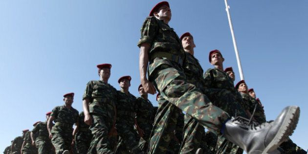 Soldiers of the Republican Guard march during the graduation ceremony for the first batch of a Personal...