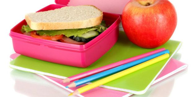 lunch box with sandwich apple...