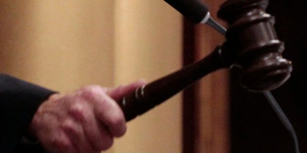 John J. Walsh, speaker pro tempore of the Michigan House of Representatives, slams the gavel after the...