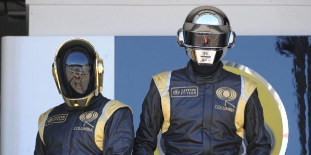 French Daft Punk band members pose in the pits at the Monaco Formula One Grand Prix at the Circuit de...