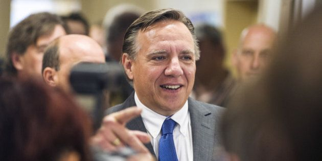 Coalition Avenir Quebec (CAQ) candidate Francois Legault arrives to vote on September 4, 2012 in l'Assomption,...
