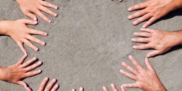 image of hands on sand