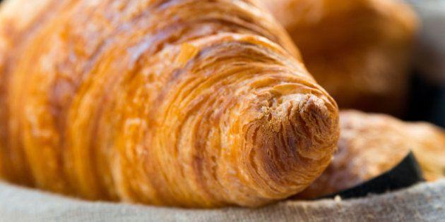 fresh croissant on table
