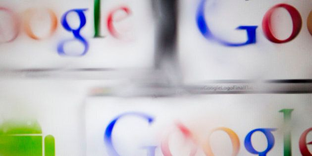 The Google Inc. and Android logos are seen through water droplets for an arranged photograph in Washington,...