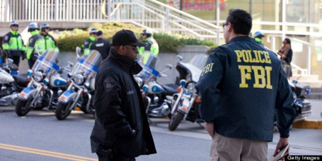 BOSTON, MA - APRIL 16: Boston police and an FBI agent patrol the streets the day after two bombs exploded...