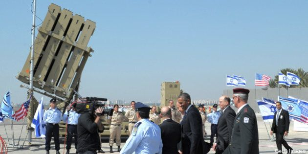 US President Barack Obama is shown an Iron Dome missile battery on March 20, 2013, at Ben Gurion International...