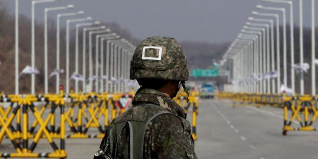 PAJU, SOUTH KOREA - APRIL 09: A South Korean soldier stands at a military check point connecting South...