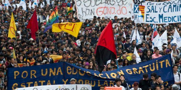 Students march during a protest to demand Chilean President Sebastian Pinera's government to improve...