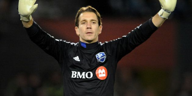 PORTLAND, OR - MARCH 09: Troy Perkins #1 of Montreal Impact signals to his teammates during the first...