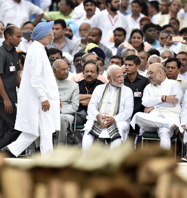 Former Prime Minister (standing), President Ramnath Kovind (Left), Prime Minister Narendra Modi (Middle)...