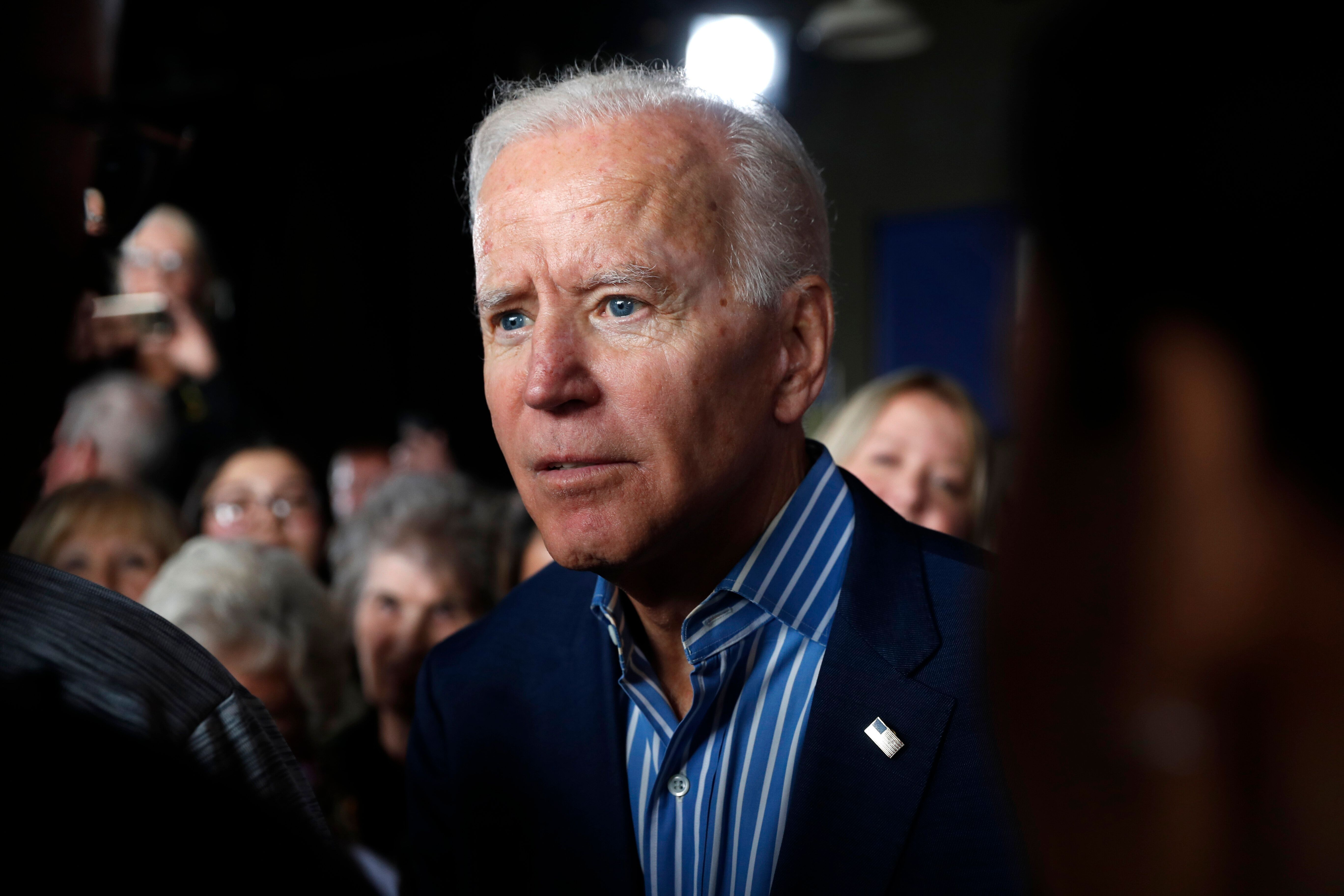 Former Vice President and Democratic presidential candidate Joe Biden greets audience members during a rally, Wednesday, May 1, 2019, in Iowa City, Iowa. (AP Photo/Charlie Neibergall)