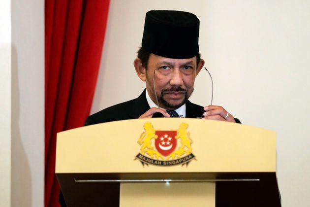 Brunei's Sultan Hassanal Bolkiah delivers a speech in Singapore on July 5,